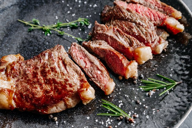 Grilled sliced ​​beef steak with rosemary close up