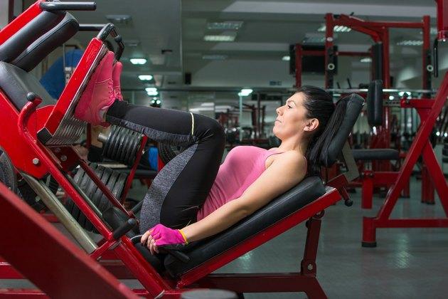 Girl doing the leg press