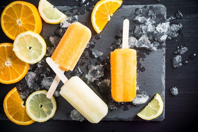 Homemade orange and lemon popsicles
