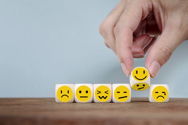 Hand Changing with smile emoticon icons face on Wooden Cube, hand flipping unhappy turning to happy symbol