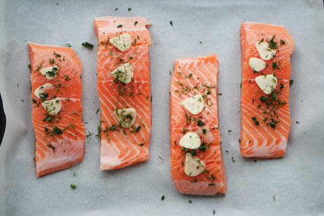 Directly Above Shot Of Salmon Steaks On Paper
