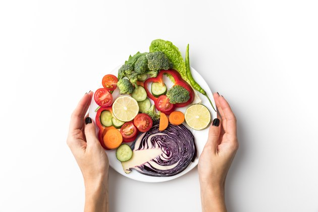 woman holding plate with salad