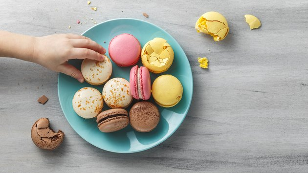 Colorful macaroons on a plate on a wooden table