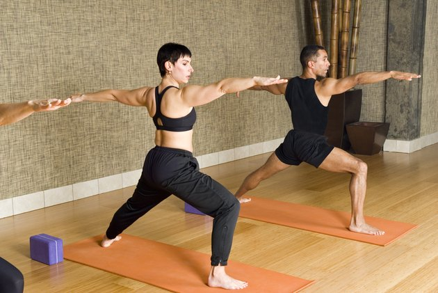 People doing Warrior II standing yoga pose for balance