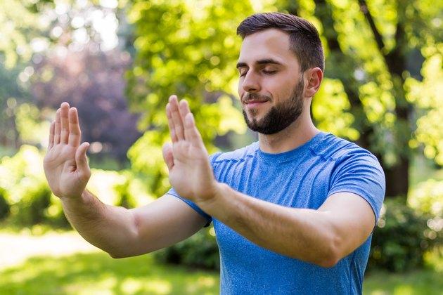 Man practicing Tai Chi outside