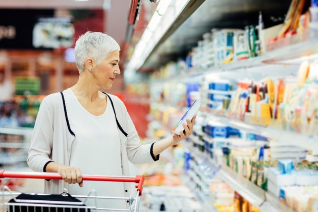 A woman over 50 grocery shopping for the best food for weight loss