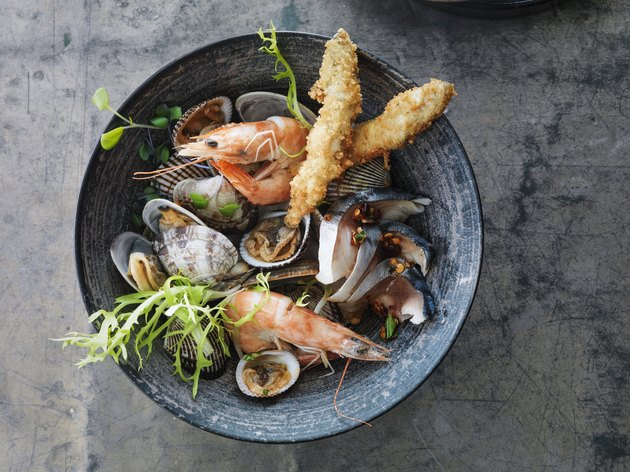 Seafood in a bowl on a metallic surface