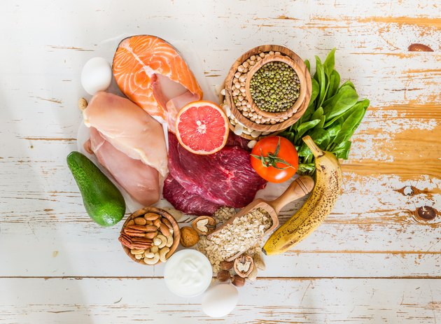 A selection of foods with healthy fats, including salmon, nuts and avocado