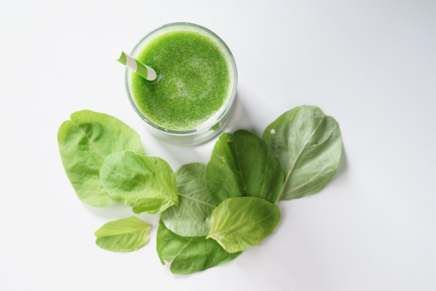 glass of fresh green spinach healthy smoothie