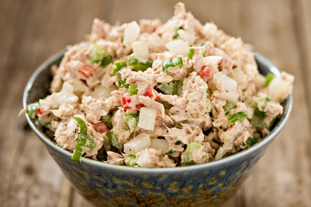 Tuna Salad in a bowl on a wooden table