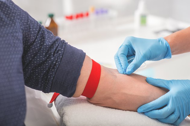 Man having blood collecting in hospital