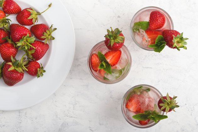 Iced cold drink with fresh strawberry