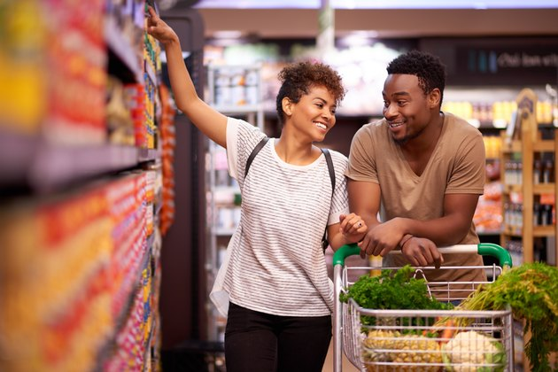 A couple trying to reduce food waste shopping at the grocery store together