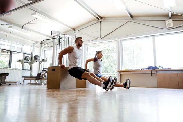 Friends working out in a home gym