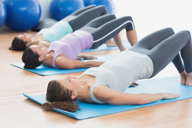 Fit class exercising at fitness studio