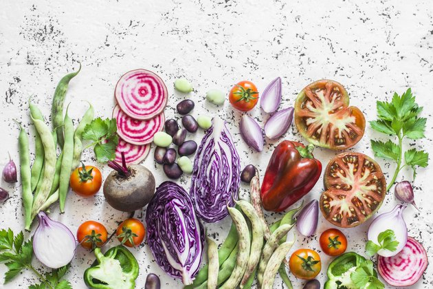 Organic fresh vegetables background. Cabbage, beets, beans, tomatoes, peppers on a light background, top view. Flat lay