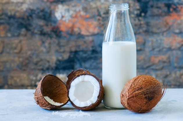 Whole coconuts and coconut products as milk and powder. White st