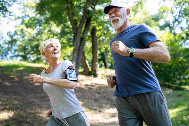 Older woman and man running outside