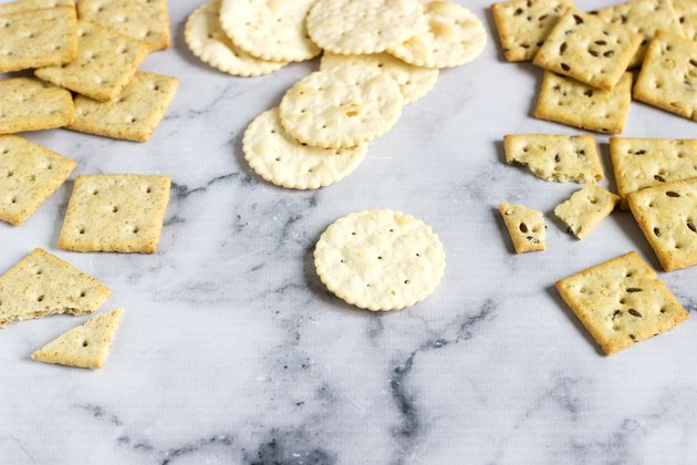 Matzo crackers, salty crackers with sesame seeds and flax seeds on a light background.
