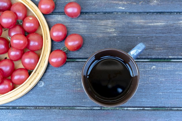 Black coffee and fresh cherry tomato