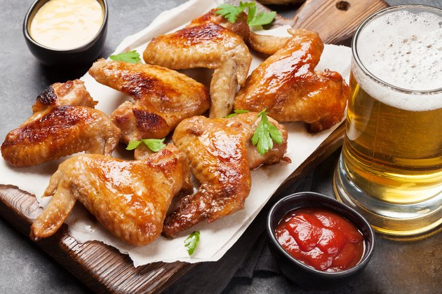 Hot chicken wings and draft beer