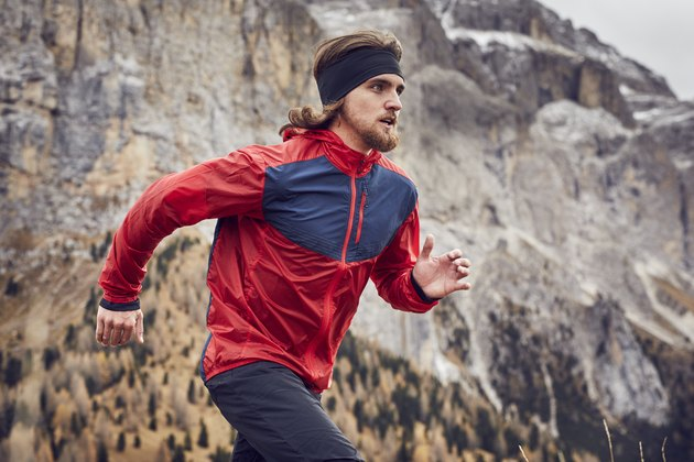 Man running in mountains in workout clothes for men