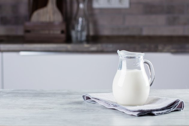 Jug of milk on concrete table background on the kitchen. Dairy Product. Copy space
