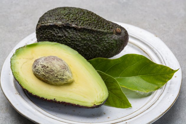 New harvest of fresh ripe hass avocado, cut in half