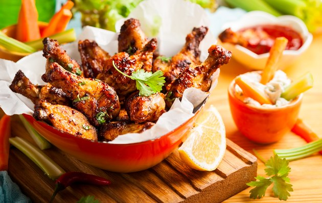 chicken wings in bowl on wooden table