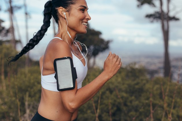 Fitness woman sprinting outdoors in morning