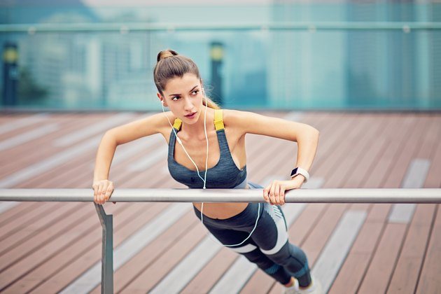 Young woman is doing push ups after run