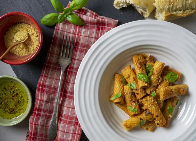 Rigatoni pasta Bolognese Vegan dish with nutritional yeast