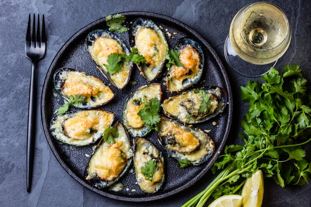 Seafood. Baked mussels with cheese and lemon in shells