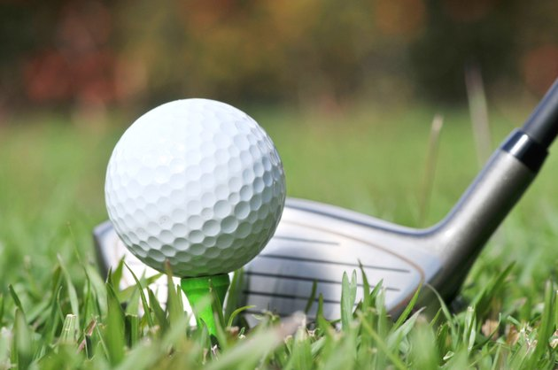 Close up of Golf Club and ball on the fairway