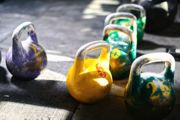 Colorful kettlebells on gym floor for weight training for weight loss