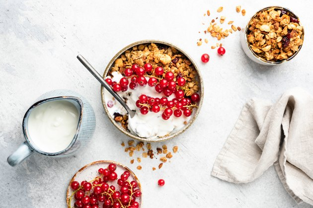 Oat granola with natural yogurt and red currant berries