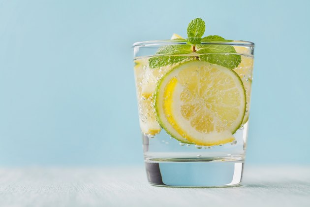 Mineral infused water with limes, lemons, ice and mint leaves