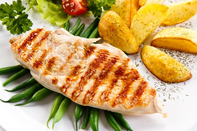 Grilled chicken breast, French fries and vegetables