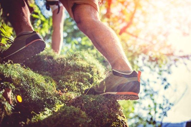 Hiker climbing on rock