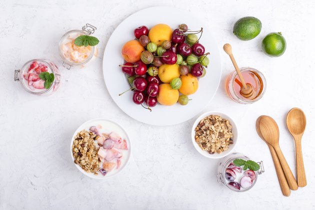 Healthy breakfast with  granola and fresh summer fruits