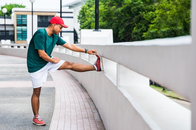 Young asian man doing static stretching for hamstring