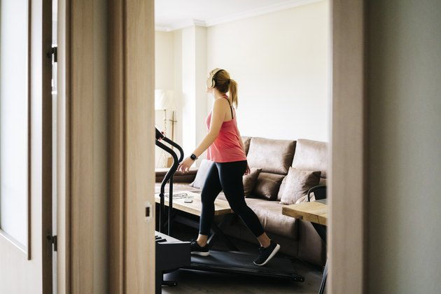 woman exercising on a treadmill at home
