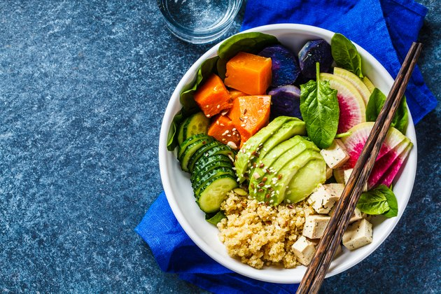 vegan quinoa salad with tofu, avocado and vegetables