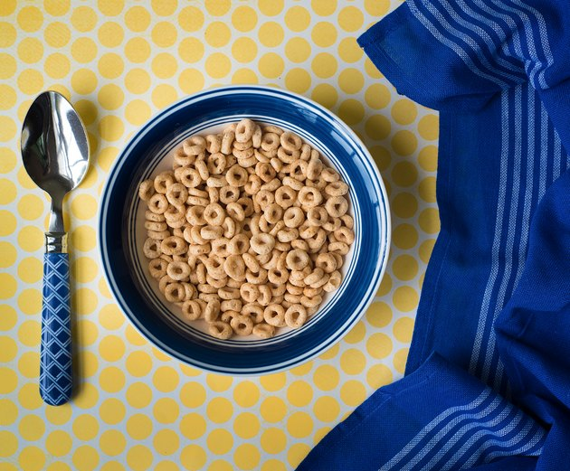 Bowl of cereal and blue kitchen towel