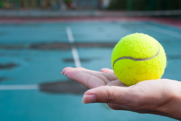 Close-Up Of Woman Hand Holding Tennis Ball
