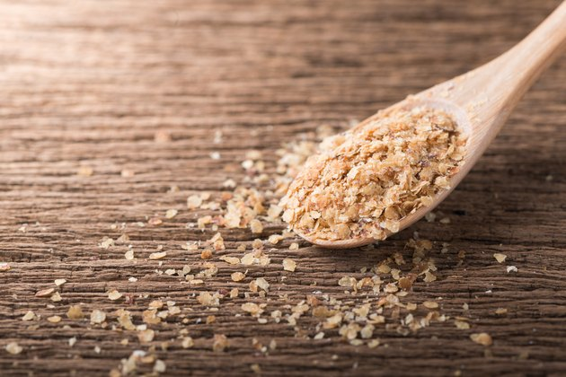 Wheat germ plant-based protein foods on wood spoon