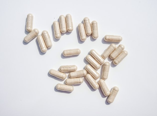 Directly Above Of Capsules On White Background