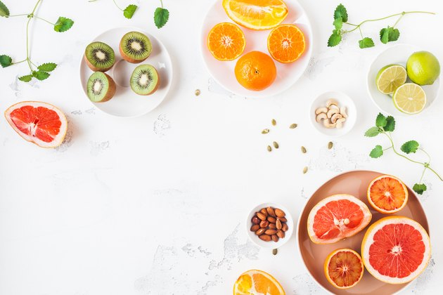 Colorful fresh fruit on white table. Flat lay, top view
