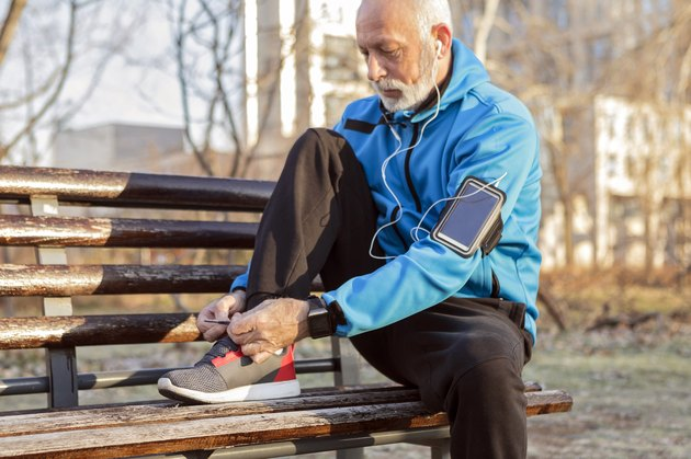 older man tying sneakers to exercise