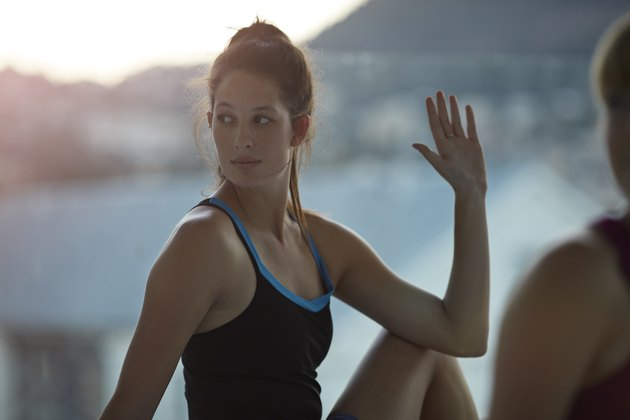 Woman doing stretch exercise at yoga class class